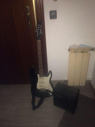 Guitarra eléctrica y altavoz