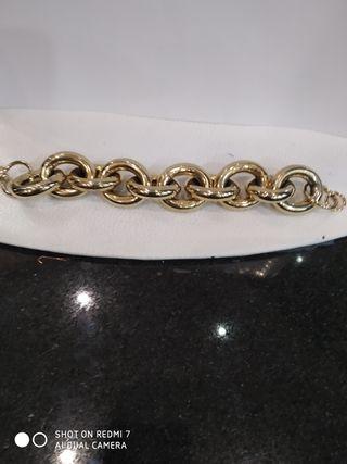 Pulsera acero macizo con baño en oro