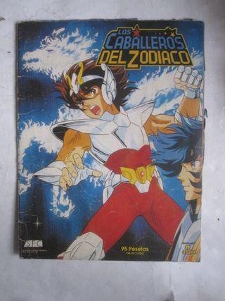 álbum de cromos Caballeros del Zodiaco Aston