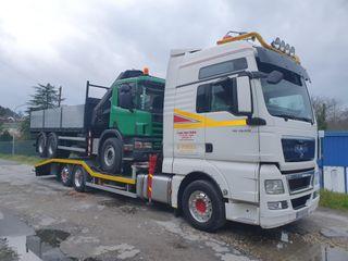 Transporte de camiones, vehículos y maquinaria