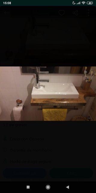 lavabo con encimera y barra para colgar