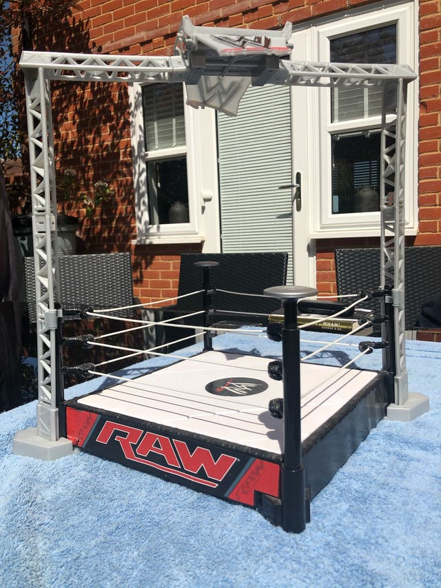 WWE ring with bit stand