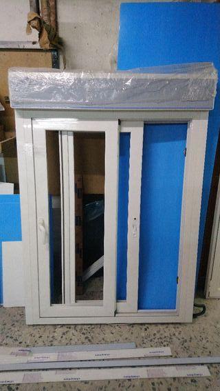 ventana PVC con persiana eléctricas