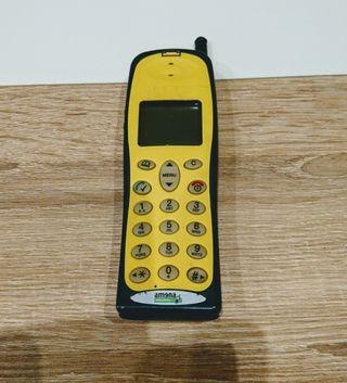 Teléfono móvil antiguo NEC amarillo