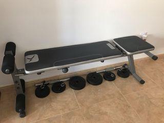 Banco de abdominales + juego de pesas