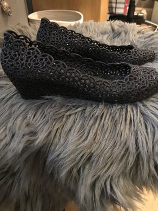 Small black sparkly heeled shoe