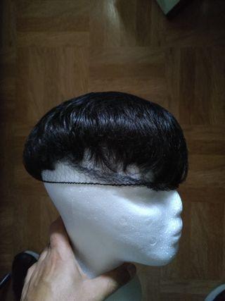 Prótesis capilar o peluca de pelo natural