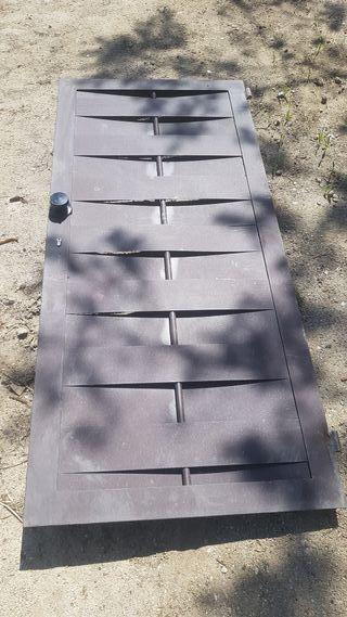 Puerta de hierro trenzado