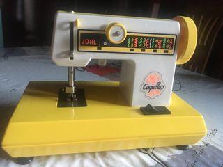 Máquina de coser coqueta de joal