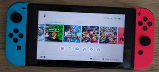 Nintendo Switch vulnerable + sd 128gb juegos