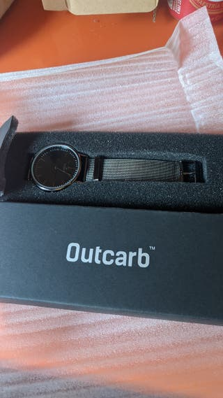 Outcarb Reloj