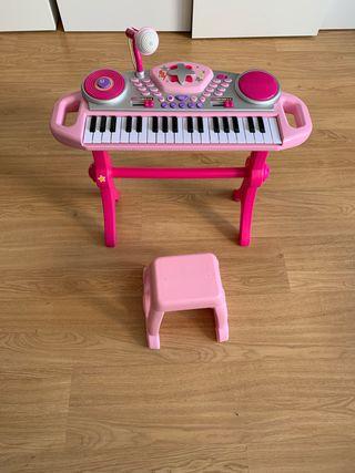 Piano de juguete para niña con su sillín