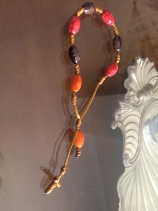 Pulsera rosario de cruz de macramé