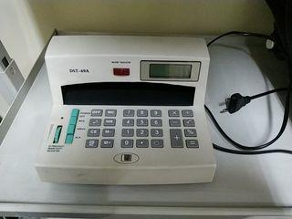 Detector billetes falsos y calculadora