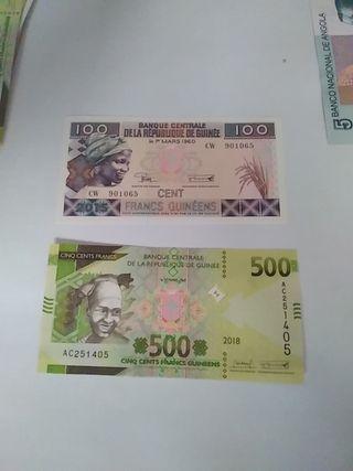 pareja billetes guinea