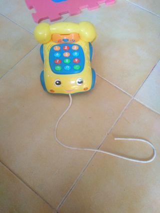 alfombra de puzzle y telefono musical