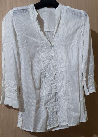 camisa manga tres cuartos