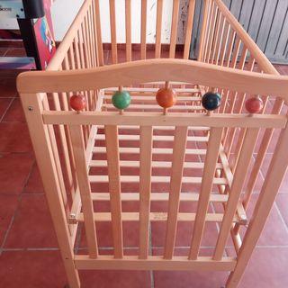 cuna de madera regulable