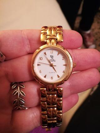 reloj de mujer bañado en oro