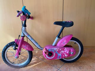Bicicleta rosa para niñx