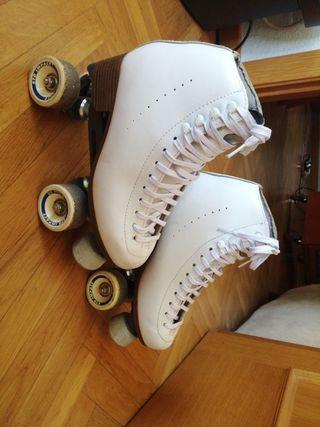 patines profesionales con dos pares de fundas