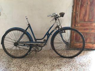 Bicicleta varillas antigua mujer