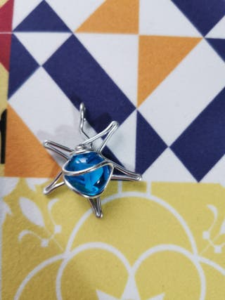 Colgante estrella y piedra azul