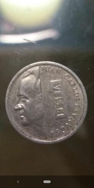 Moneda 1 peseta 1990, error en el reverso