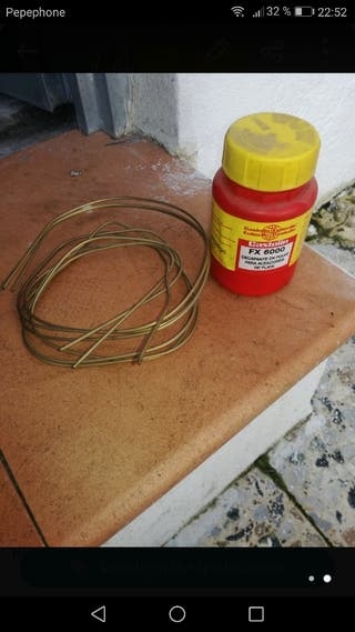 alambre de latón y decapante en polvo