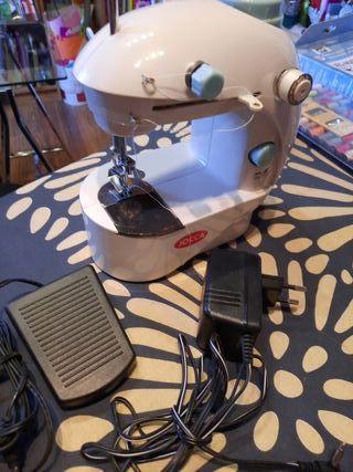 máquina portátil de coser
