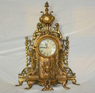 reloj bronce y candelabros bronce