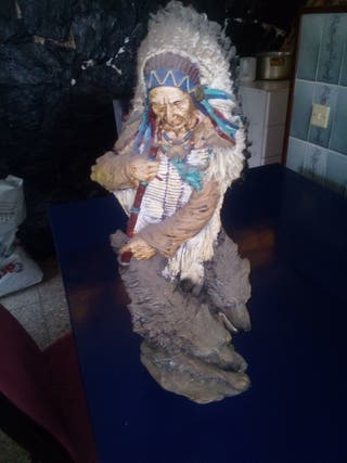indio de ceramica con lobo