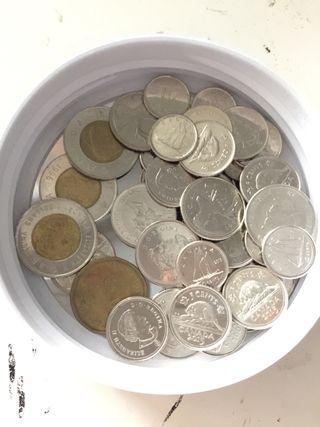 12$ Monedas canadienses   Dólares Can