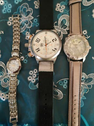 tres relojes,dos de mujer y uno de hombre