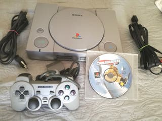 PlayStation 1 Impecable con mando y un juego