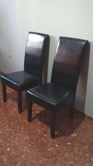 2 sillas de piel color marrón