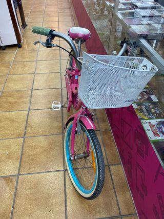Bicicleta niña rosa con cesta