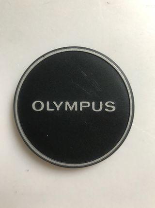 Tapa antigua metálica Olympus