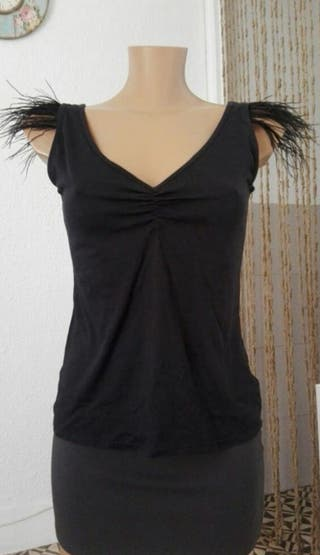 camiseta negra plumas fridays project