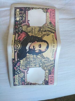 Antigua funda para billetes