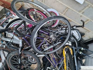 A LOT OF SPARE BIKES AND BIKE PARTS