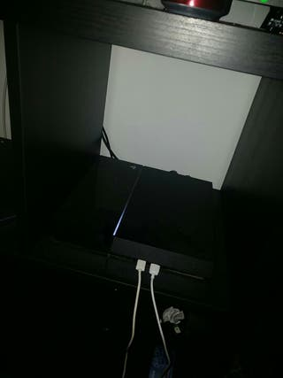 playstation 4 with games and headset