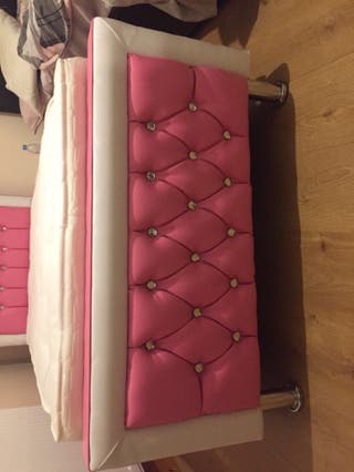 Pink and white leather single bed with mattress