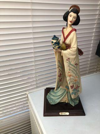 A Balcari Geisha girl figure