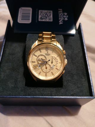 reloj dorado festina