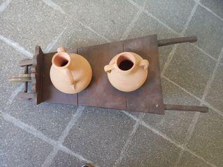 carretilla antigua con cántaros