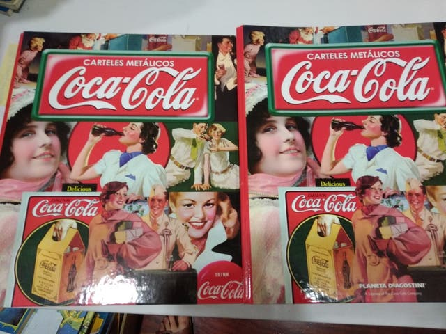 HISTORIA DE CARTELES PUBLICITARIOS DE COCA COLA