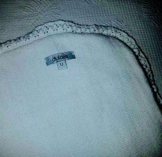 """Saco bebé de lana marca """"Dulces""""."""
