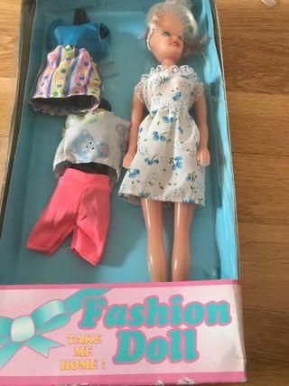 Muñeca fashion doll.
