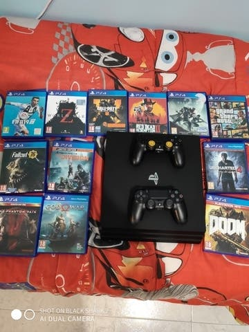 PS4 1T + 2 mandos + 12 videojuegos